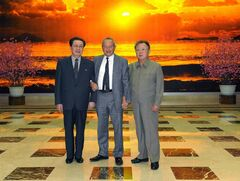 Egyptian magnate Naguib Sawiris is flanked by the late North Korean leader Kim Jong Il (right) and defence official Jang Song Thaek in 2011.