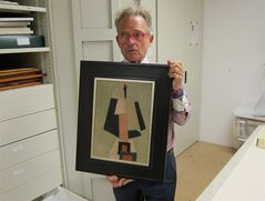 Tom Butterfield, founder and creative director of the Masterworks Museum of Bermuda Art, holds Marsden Hartley's 1917 work