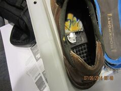 This July 6, 2014 photo provided by the Transportation Security Administration shows a knife concealed inside the bottom lining of a shoe belonging to a passenger at Detroit Metropolitan Airport in Romulus, Mich. The TSA says airport police responded, took possession of the knife and arrested the passenger. (AP Photo/Transportation Security Administration)
