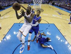 Oklahoma City Thunder forward Kevin Durant (35) goes up for a shot in front of Los Angeles Clippers forward Danny Granger (33) and forward Jared Dudley (9) in the second quarter of Game 1 of the Western Conference semifinal NBA basketball playoff series in Oklahoma City, Monday, May 5, 2014. (AP Photo/Sue Ogrocki)