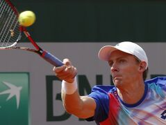 South Africa's Kevin Anderson returns the ball to Croatia's Ivo Karlovic during their third round match of the French Open tennis tournament at the Roland Garros stadium, in Paris, France, Saturday, May 31, 2014. (AP Photo/Michel Euler)