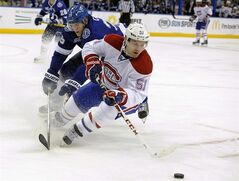 Montreal Canadiens center David Desharnais defends the puck on Feb. 12, 2013, in Tampa, Fla. Desharnais had to prove a lot of people wrong before he hit the jackpot with a four-year, US$14 million contract with the Montreal Canadiens. THE CANADIAN PRESS/AP, Brian Blanco