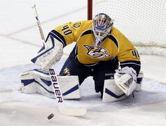 Nashville Predators goalie Devan Dubnyk (40) makes a stop against the Colorado Avalanche in the second period of an NHL hockey game Saturday, Jan. 18, 2014, in Nashville, Tenn. THE CANADIAN PRESS/AP/Mark Humphrey