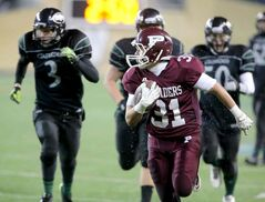 Austin Coutts of the The St. Paul's Crusaders runs for an easy touchdown.