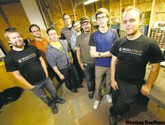 Ron Bowes, Justin Lacko and Mike Loney (right side of photo) with other members at SkullSpace.
