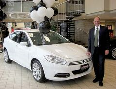 Steinbach Dodge Chrysler Fiat president Paul Neustaedter with 2013 Dodge Dart.
