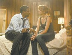 Denzel Washington and Kelly Reilly.