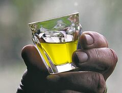 A glass of olive oil: Soak cotton ball in olive oil and gently rub it over bandage to loosen it.
