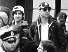 Tsarnaev brothers Dzhokar (white cap) and Tamerlan (dark cap sunglasses) captured on a surveillance camera at the Boston Marathon.