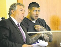 Aaron Hernandez (right) and lawyer Michael Fee apply for bail for Hernandez on Thursday in Fall River, Mass., court. The judge denied the request.