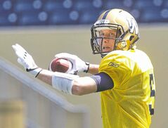 Winnipeg Blue Bombers� QB Drew Willy (5) during practice at Investors Group Field Monday morning.  140804 August 4, 2014 Mike Deal / Winnipeg Free Press