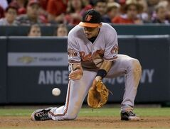 Baltimore Orioles third baseman Ryan Flaherty filed a ball hit by Los Angeles Angels' Chris Iannetta during the fifth inning of a baseball game in Anaheim, Calif., Wednesday, July 23, 2014. (AP Photo/Chris Carlson)