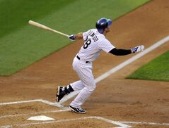 Colorado Rockies Nolan Arenado hits a two-run home run in the third inning of a baseball game against the Washington Nationals on Tuesday, July 22, 2014, in Denver. (AP Photo/Chris Schneider)
