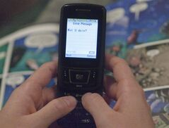 A text message is sent on a mobile phone, November 9, 2010 in Montreal. A Supreme Court ruling Wednesday is expected to clarify whether police need a search warrant or wiretap authority to snoop on cell phone text messages as part of criminal investigations. THE CANADIAN PRESS/Ryan Remiorz