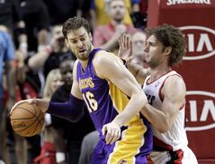 Los Angeles Lakers center Pau Gasol, left, backs in on Portland Trail Blazers center Robin Lopez during the second half of an NBA basketball game in Portland, Ore., Monday, March 3, 2014. The Chicago Bulls recovered quickly after losing out on Carmelo Anthony in free agency, landing Los Angeles Lakers big man Pau Gasol to bolster the team's offence. THE CANADIAN PRESS/AP, Don Ryan