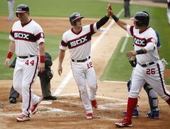 Chicago White Sox's Conor Gillaspie celebrates his grand slam with teammates Avisail Garcia, right, and Adam Dunn, left, during the first inning of a baseball game against the Toronto Blue Jays, Sunday, Aug. 17, 2014, in Chicago, Ill. (AP Photo/Andrew A. Nelles)
