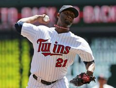 Minnesota Twins pitcher Samuel Deduno throws against the Texas Rangers in the first inning of a baseball game Thursday, May 29, 2014, in Minneapolis. (AP Photo/Jim Mone)