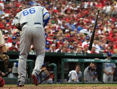 Los Angeles Dodgers' Yasiel Puig drops his bat after being hit by a pitch during the third inning of a baseball game against the St. Louis Cardinals Saturday, July 19, 2014, in St. Louis. Puig left the game in the eighth inning and the Cardinals went on to win 4-2. (AP Photo/Jeff Roberson)