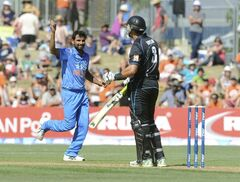 India's Mohammed Shami, left, celebrates after dismissing New Zealand's Ross Taylor for 52 during their first one-day international cricket match, at McLean Park, in Napier, New Zealand, Sunday, Jan.19, 2014. (AP Photo/SNPA, Ross Setford) NEW ZEALAND OUT