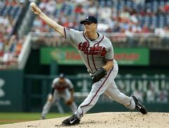 Atlanta Braves starting pitcher Gavin Floyd throws during the first inning of a baseball game against the Washington Nationals at Nationals Park Thursday, June 19, 2014, in Washington. (AP Photo/Alex Brandon)