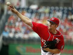 Washington Nationals starting pitcher Stephen Strasburg throws during the first inning of a baseball game against the Philadelphia Phillies at Nationals Park Sunday, Aug. 3, 2014, in Washington. (AP Photo/Alex Brandon)