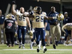 Winnipeg Blue Bombers running back Carl Volny (29) celebrates after defeating the Hamilton Tiger-Cats during second half CFL football action in Hamilton, Ont., on Thursday, July 31, 2014. THE CANADIAN PRESS/Nathan Denette