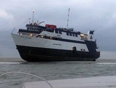 In this photo provided by the U.S. Coast Guard, tThe casino boat Escapade, with 123 people aboard, is grounded off the coast of Tybee Island, Ga., Wednesday, July 16, 2014. No injuries or medical issues had been reported among the 96 passengers and 27 crew members aboard the boat according to Coast Guard Petty Officer 3rd Class Anthony L. Soto. (AP Photo/U.S. Coast Guard)