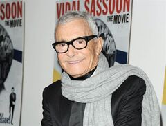 In this Feb. 9, 2011 file photo released by Starpix, hair designer and businessman, Vidal Sassoon, stops for a photo at a special screening of