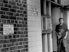 "CORRECTS SPELLING FROM HERRON TO HERNDON In this Sept. 28, 1994 photo, Ronald Herron, 12, stands in the doorway of the Gowanus Houses in New York. Now 32 and sometimes known as the Rapper ""Ra Diggs,"" Herndon is accused by prosecutors as the ruthless leader of a violent drug gang, and faces a federal murder trial in New York. The government and defense are locked in a debate whether Herndon's music and videos are evidence of real crimes committed by one of the city's highest ranking Bloods or are constitutionally protected, and inadmissible, expressions of free speech that his lawyers have likened to Johnny Cash's"
