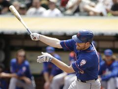 New York Mets' Daniel Murphy strikes out swinging against Oakland Athletics starting pitcher Jeff Samardzija in the first inning of their interleague baseball game Wednesday, Aug. 20, 2014, in Oakland, Calif. (AP Photo/Eric Risberg)