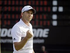 Sergio Garcia, from Spain, pumps his fist after a birdie on the 18th green dropped him to 11-under par after the second round of the Bridgestone Invitational golf tournament Friday, Aug. 1, 2014, at Firestone Country Club in Akron, Ohio. (AP Photo/Mark Duncan)