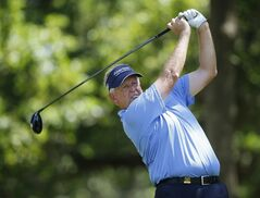 Colin Montgomerie hits from the fifth tee during the second round of the U.S. Senior Open golf tournament at Oak Tree National in Edmond, Okla., Friday, July 11, 2014. (AP Photo/Sue Ogrocki)