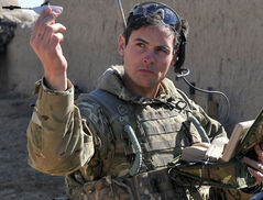 Sergeant Scott Weaver, of The Queens Royal Lancers, launches a Black Hornet drone from a compound in Afghanistan.