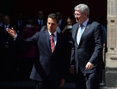 Prime Minister Stephen Harper is greeted by Mexican President Enrique Pena Nieto as he arrives at the National Palace in Mexico City, Mexico on Tuesday, Feb.18, 2014. THE CANADIAN PRESS/Sean Kilpatrick