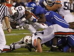 Auburn's Mario Fannin dives for extra yardage against Kentucky during an NCAA football game in October 2010.