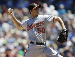Baltimore Orioles starting pitcher Miguel Gonzalez throws in the second inning of a baseball game against the Seattle Mariners, Sunday, July 27, 2014, in Seattle. (AP Photo/Ted S. Warren)