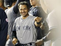 New York Yankees ' Brian Roberts smiles in the dugout after he scored on a single hit by Yankees' Derek Jeter in the fourth inning of a baseball game against the Seattle Mariners, Thursday, June 12, 2014 in Seattle. (AP Photo/Ted S. Warren)