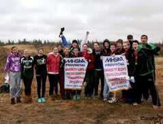 The Vincent Massey cross-country team celebrates with its pair of provincial championship banners. Madison Mislawchuk (from left), Laura Bobrowski, Tarina Ready, Julia Snell, Janine Zajac, Mikaela Van Schepdael, Ashlyn Cortvriendt, Kendra Friesen, Darian Hole, Corey Arsenault, Tyler Van Schepdael, Sam Murphy, Matt Van  Schepdael and Shamael Azami. In back (from left): Coaches Curtis Fazackerley, Liam Francis and Andy Tough.