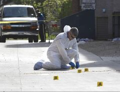 Police work at crime scene.