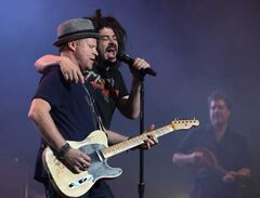 Counting Crows singer Adam Duritz (right) and guitarist Dan Vickrey perform at the Centennial Concert Hall Wednesday.
