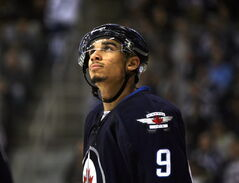 Evander Kane looks at the scoreboard during a 2013 game against the Nashville Predators.