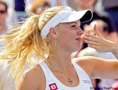 Caroline Wozniacki blows a kiss to fans after winning the Rogers Cup Monday.