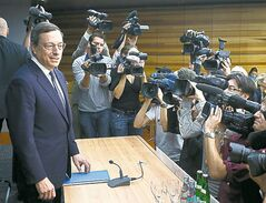 European Central Bank boss Mario Draghi faces the media.