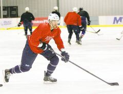 Winnipeg Jets captain Andrew Ladd skates at the MTS Iceplex on Monday. Ladd says he wants to play somewhere this season, and that may well turn out to be in Europe.