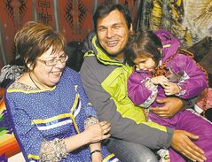 Chief Theresa Spence (from left), aboriginal actor Adam Beach and his daughter Phoenix Beach share a laugh Tuesday in Spence's teepee near Parliament Hill.