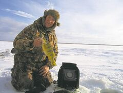 Jim Price with a Manitoba Master Angler perch. Not many anglers target the bigger perch, but there are great ice-fishing techniques for tempting them to bite.