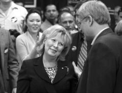 Pamela Wallin speaks with Stephen Harper in happier times in April 2011.