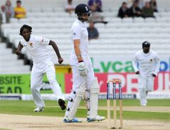 Sri Lanka's Nuwan Pradeep, left, celebrates after bowling England's Joe Root caught Lahiru Thirimanne for 31 runs during day five of the Second Test Match between England and Sri Lanka at Headingley cricket ground, Leeds, England, on Tuesday, June 24, 2014. (AP Photo/Rui Vieira)