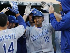 Kansas City Royals' Raul Ibanez is greeted in the dugout after hitting a home run against the Oakland Athletics during the fifth inning of a baseball game, Friday, Aug. 1, 2014, in Oakland, Calif. (AP Photo/George Nikitin)
