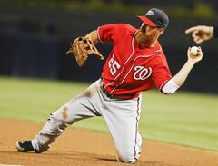 Washington Nationals first baseman Adam LaRoche throws out San Diego Padres' Jace Peterson at first after making a diving stop along the foul line during the fourth inning of a baseball game Saturday, June 7, 2014, in San Diego. (AP Photo/Lenny Ignelzi)